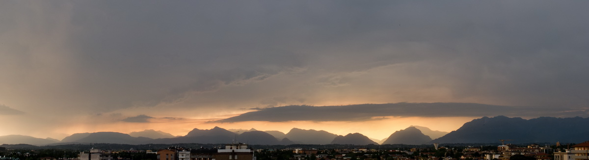 udine, thunderstorm and sunset
